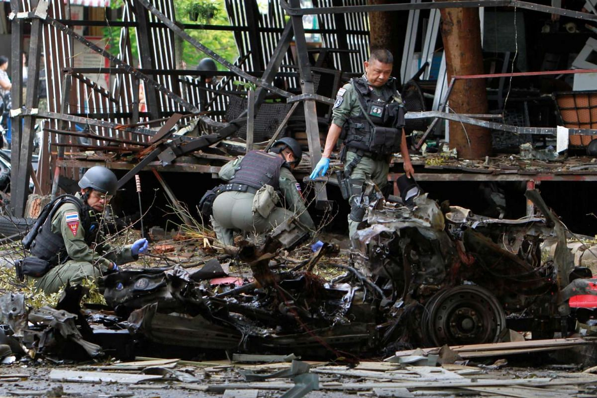 Thai soldiers inspect the scene of a car bomb blast outside a hotel in the southern province of Pattani, Thailand on Aug 24, 2016.
