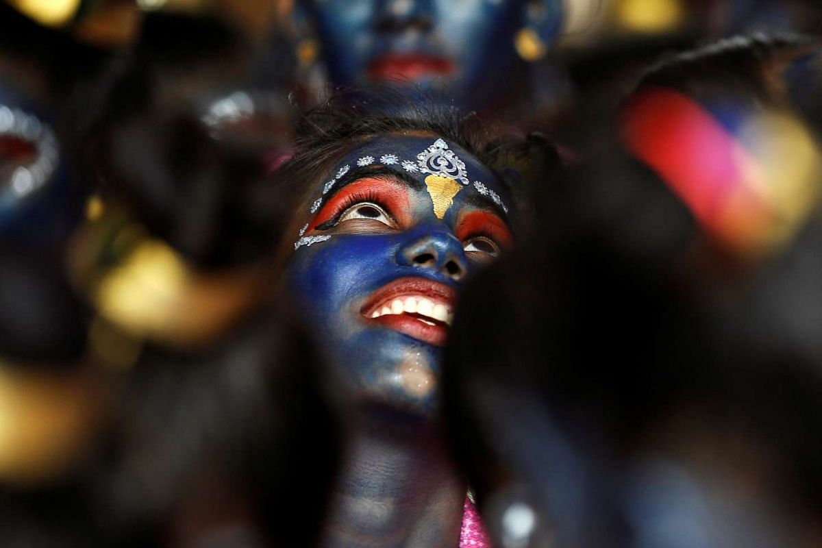 Students participate in celebrations ahead of the Janmashtami festival, which marks the birth anniversary of Lord Krishna in Mumbai, India, on Aug 23, 2016.