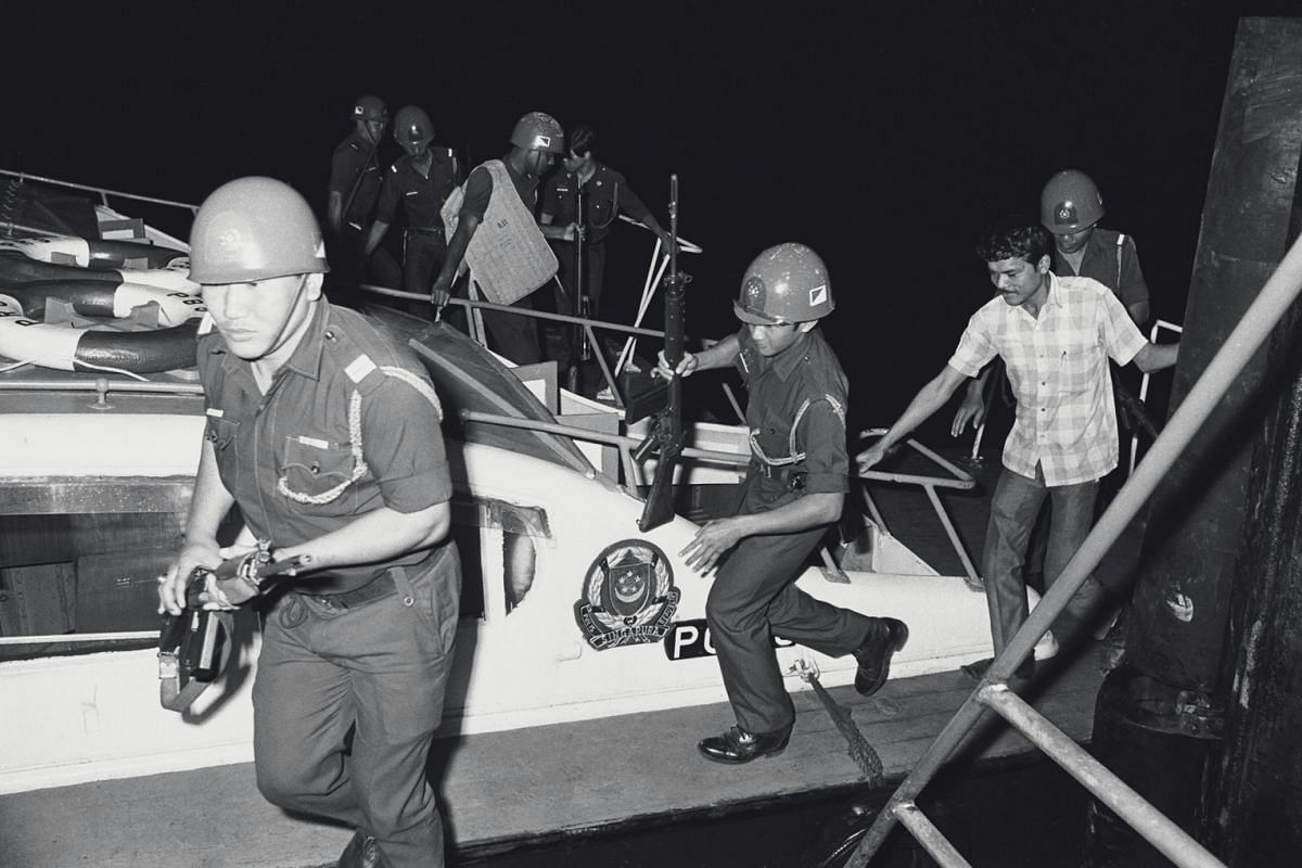 Reserve Unit troops returning to Tanjong Berlayar from Pulau Bukom, where they had searched unsuccessfully for the fourth terrorist. The whereabouts of the fourth man had initially been a mystery, as he had not been spotted on board Laju.