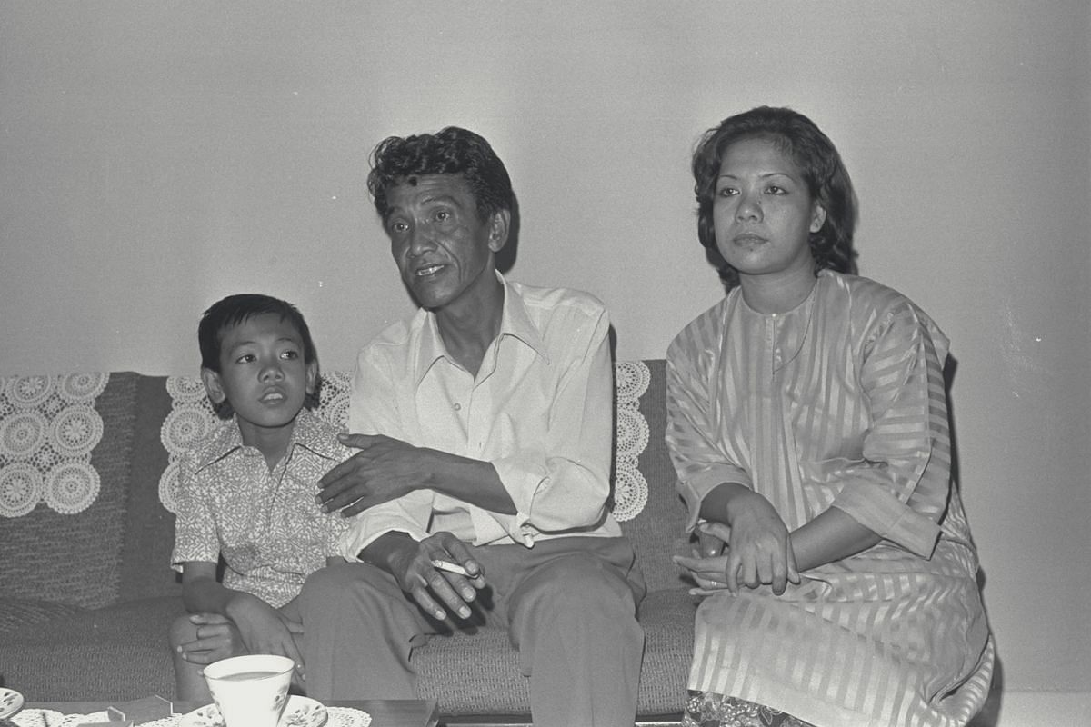 One of the hostages, Mr Mohammed Nik, with his wife Latifah and son Zailani at their home in Whampoa West. He recounted the nightmare of his eight days living on the brink of death aboard the Laju.