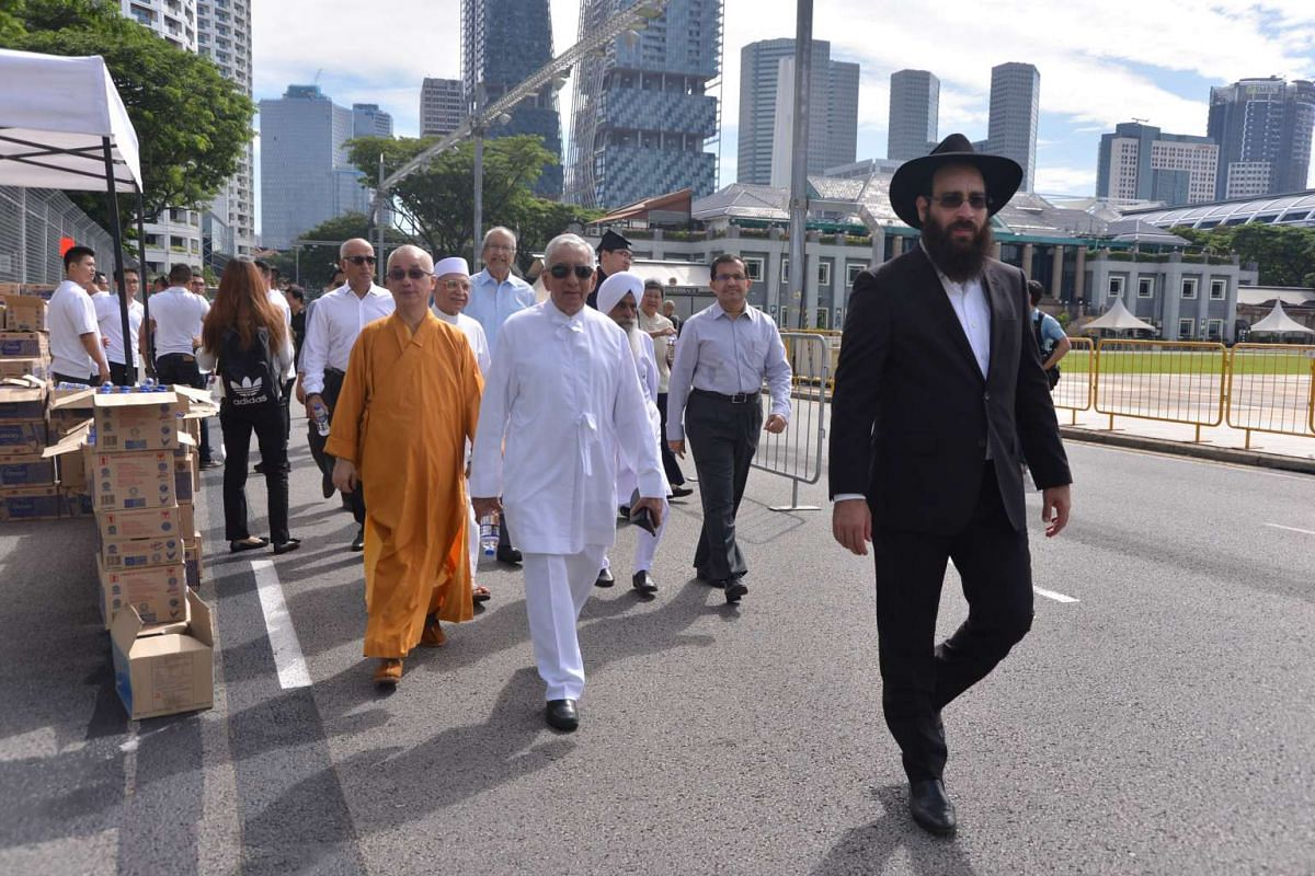 Representatives of various religious groups walking towards Parliament House to pay their respects to the late Mr S R Nathan on Aug 25.