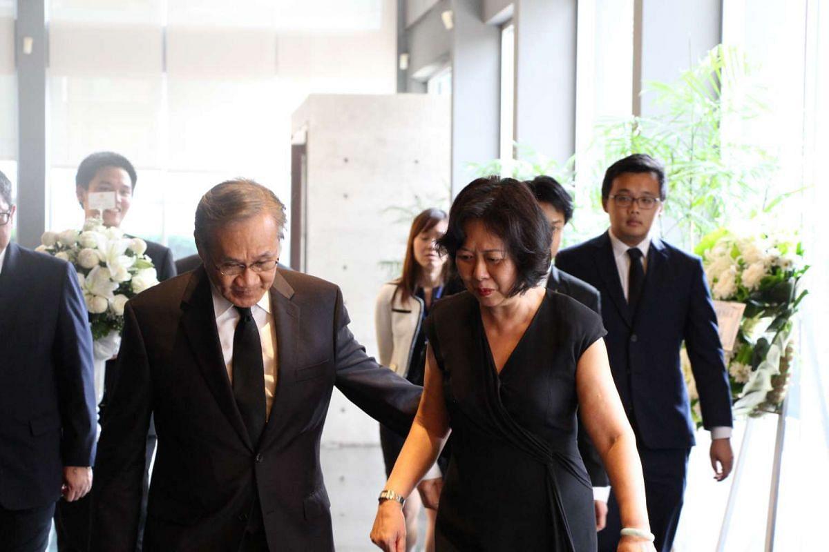 Thailand's Foreign Minister Don Pramudwinai (left) walking with Singapore's ambassador to Thailand Chua Siew San (right).