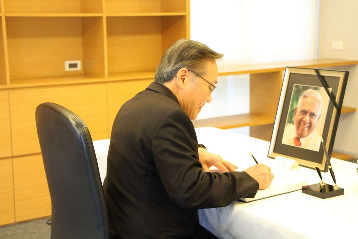 Thailand's Foreign Minister Don Pramudwinai signs the condolence book in his capacity as Prime Minister Prayut's representative and also in his capacity as Foreign Minister at the Embassy of the Republic of Singapore in Bangkok.
