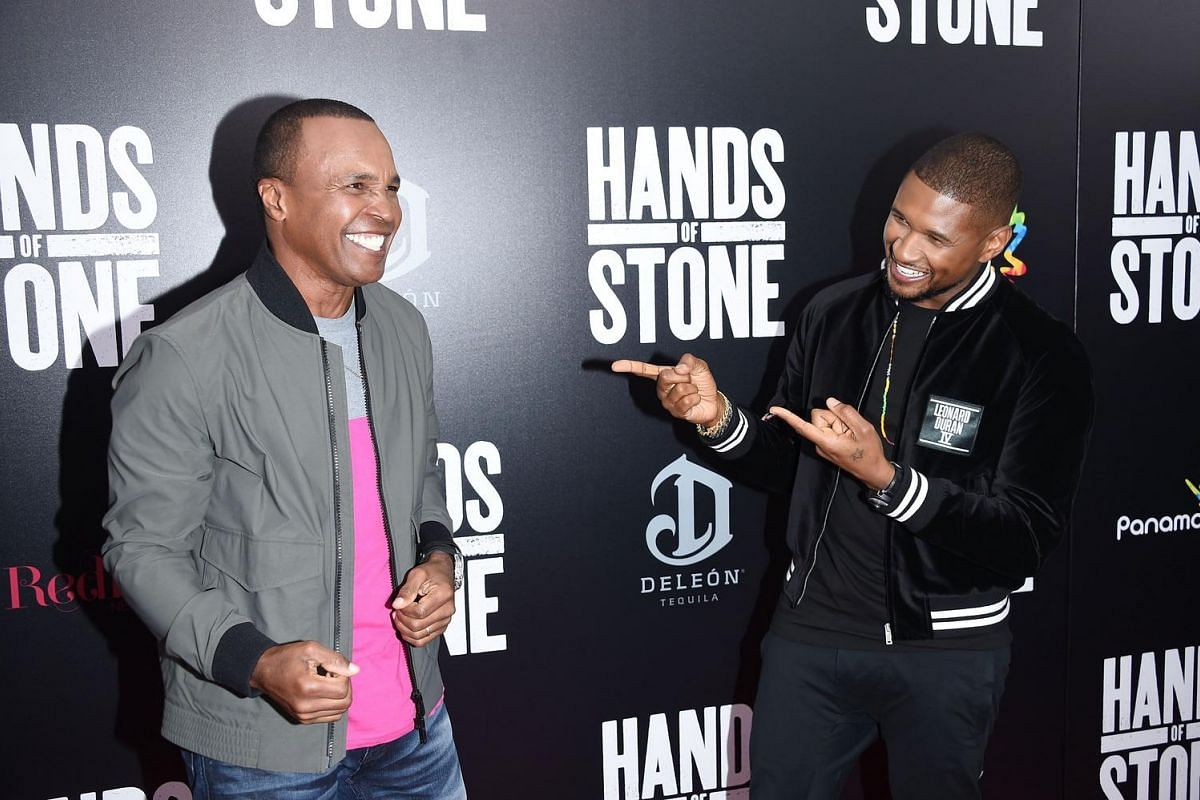 Usher (right) with boxer Sugar Ray Leonard whom he portrays in Hands Of Stone at the movie premiere at SVA Theater on Aug 22, 2016 in New York City.