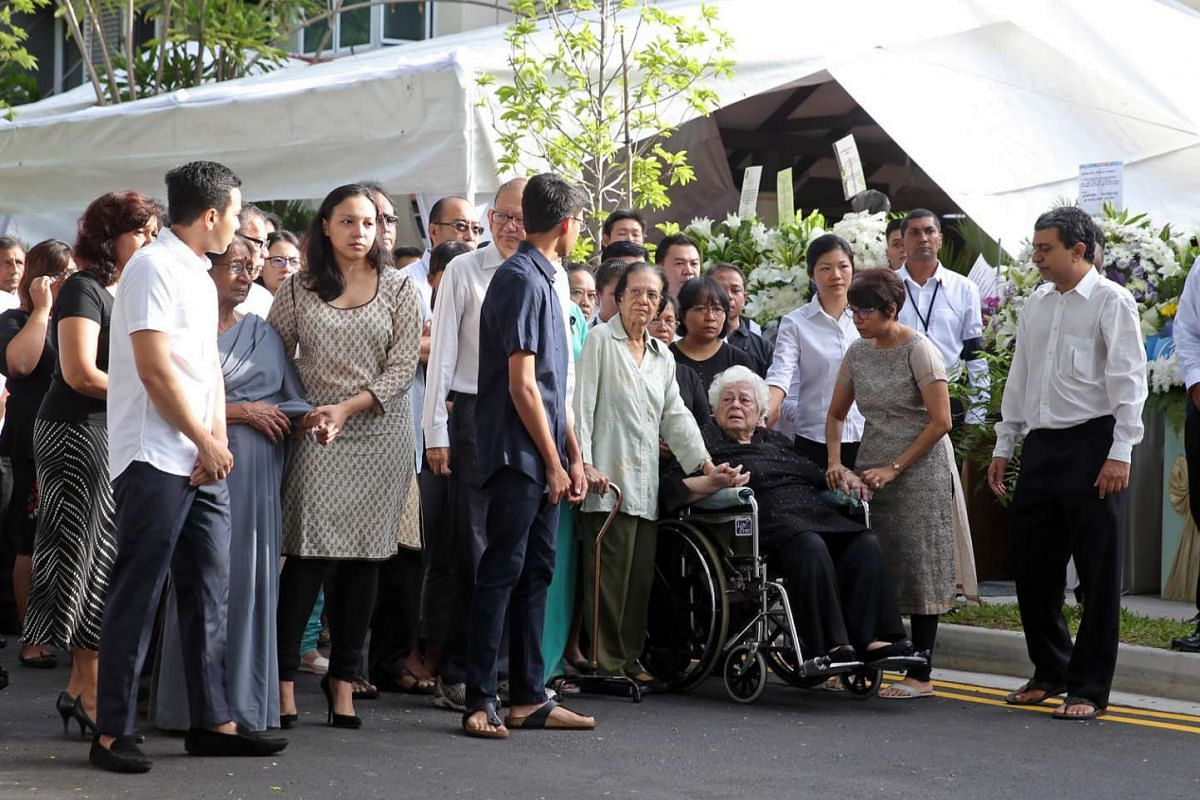Family members including Mrs Nathan follow the casket bearing the body of former president S R Nathan as it leaves his house at Ceylon Road for Parliament House on Aug 25.