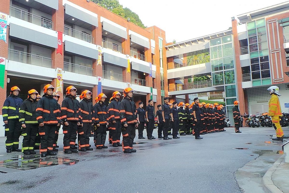 Firemen gather in the courtyard of the Central Fire Station at 8am sharp for a handover-takeover ceremony.