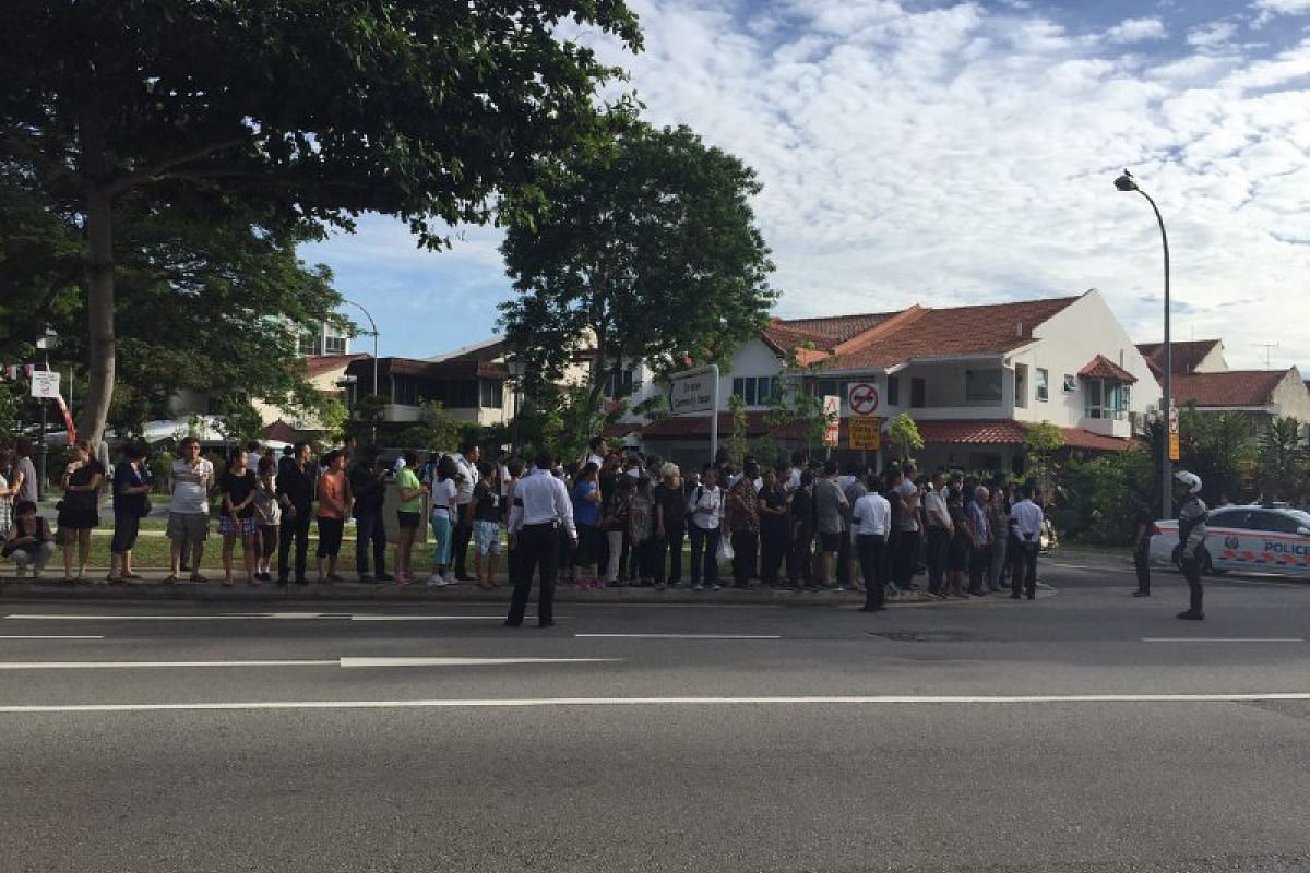 People waiting outside former president S R Nathan's Ceylon Road home to pay their respects.