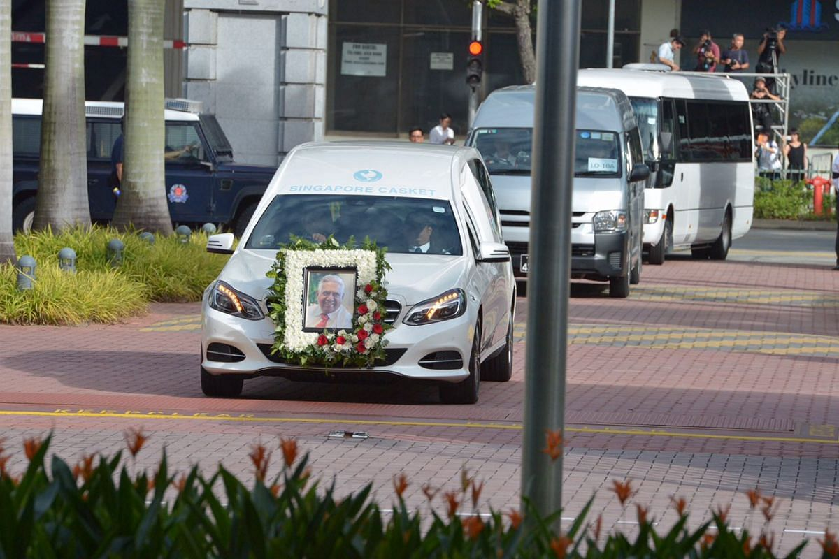 Former president S R Nathan's hearse leaves his Ceylon Road home for Parliament House on Aug 25.