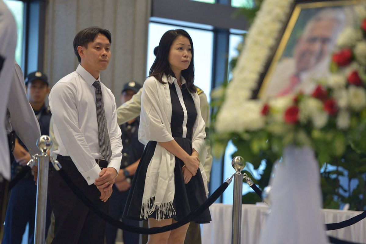 Mr Louis Ng and MP Cheng Li Hui paying their respects to Mr S R Nathan on Aug 25.