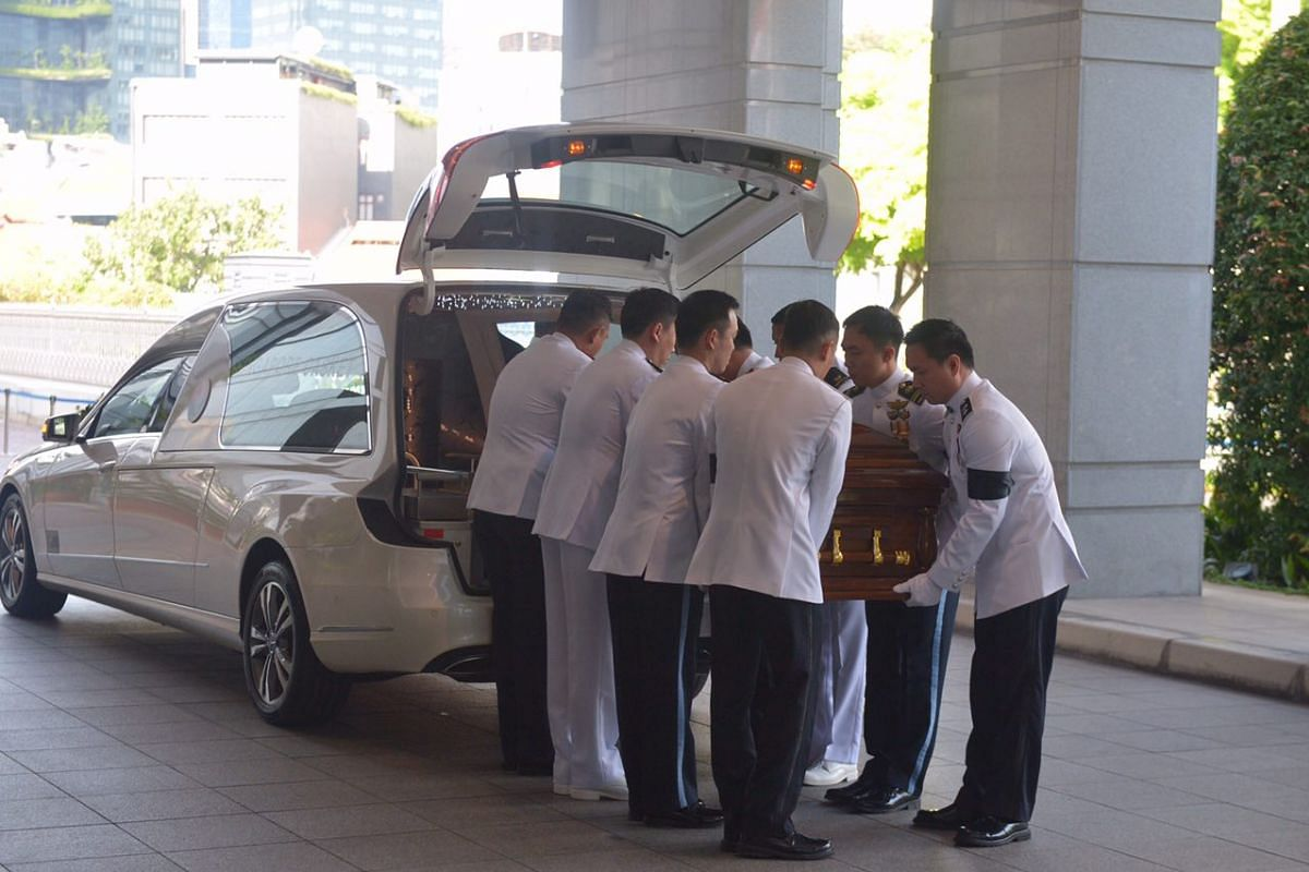 The coffin bearer team carries Mr S R Nathan's casket into Parliament House on Aug 25.