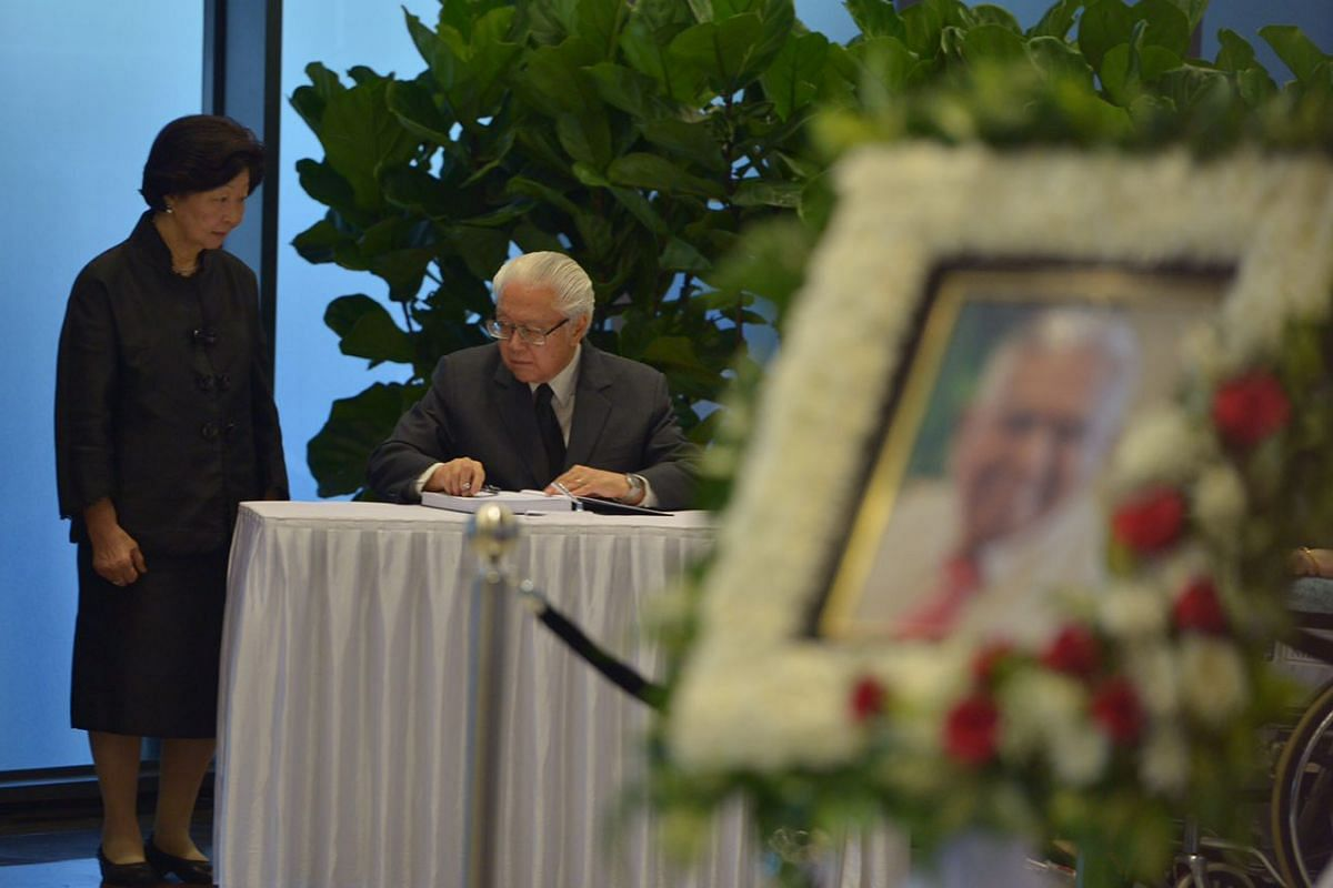 President Tony Tan and Mrs Tan paying their respects to Mr S R Nathan at Parliament House on Aug 25.