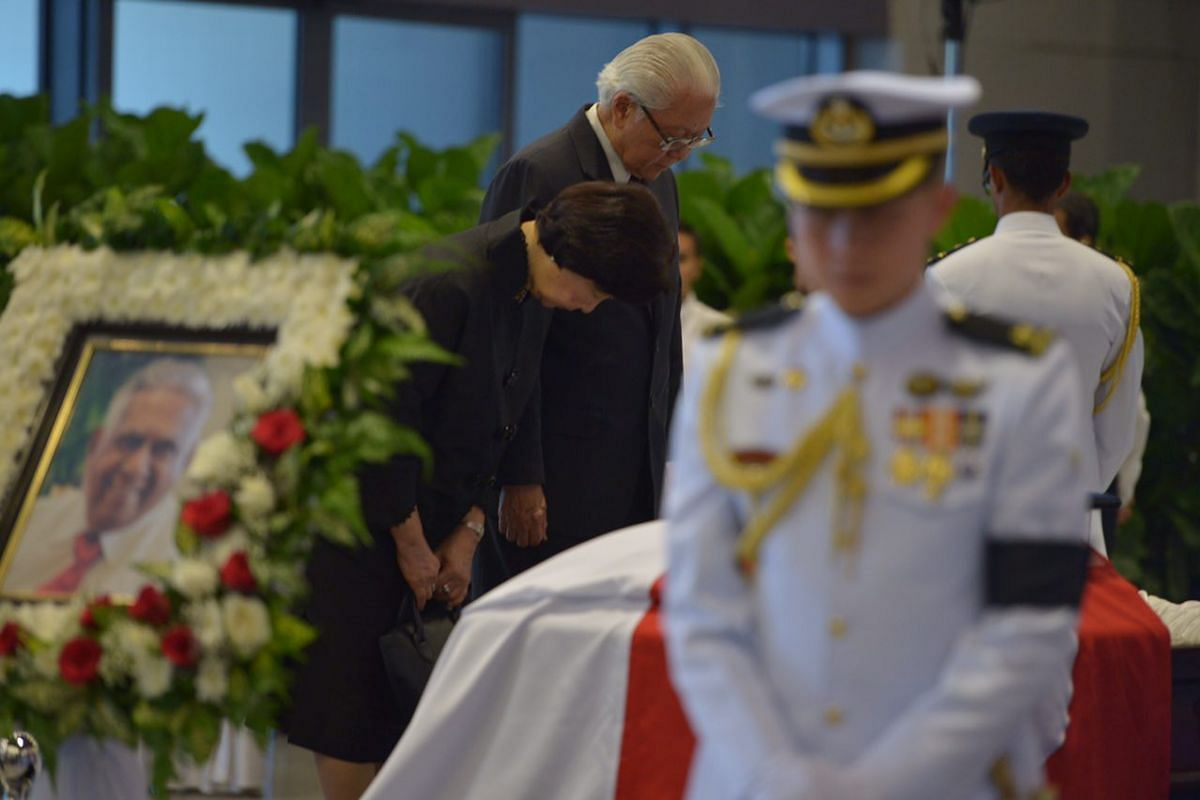 Mr and Mrs Tony Tan paying their respects to Mr S R Nathan at Parliament House on Aug 25.