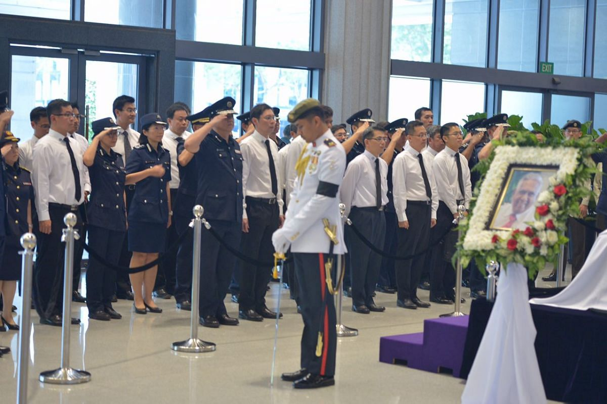 Staff from Singapore Police Force paying their respects to Mr S R Nathan on Aug 25.