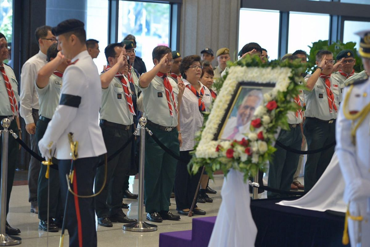 Groups of people paying their respects to Mr S R Nathan at Parliament House on Aug 25.
