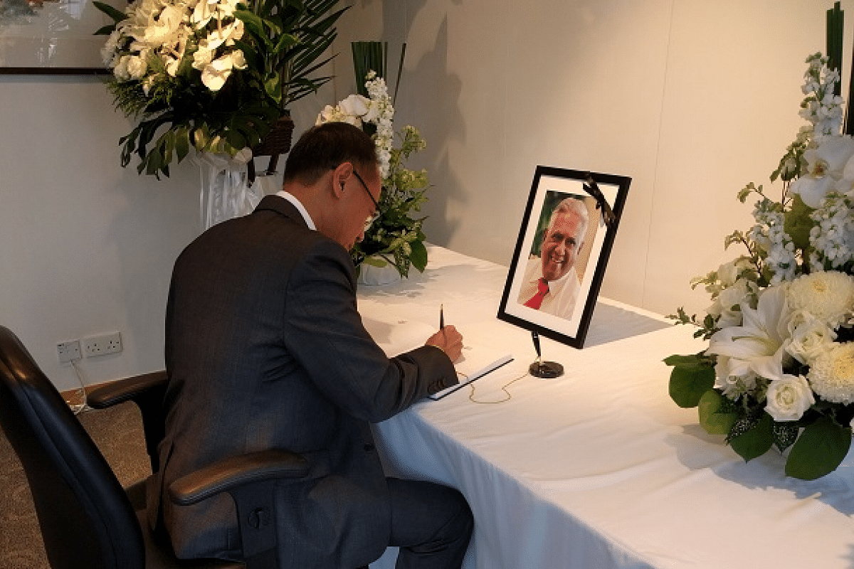Singapore's former Foreign Minister George Yeo signed the condolence book at the Consulate-General of the Republic of Singapore in Hong Kong.