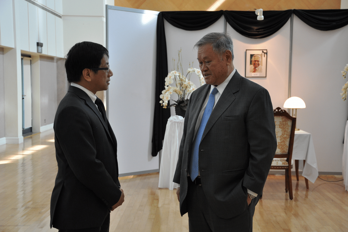 Brunei's Minister at the Prime Minister's Office and Second Minister of Foreign Affairs and Trade Pehin Dato Lim Jock Seng (right) at the High Commission of the Republic of Singapore in Brunei.