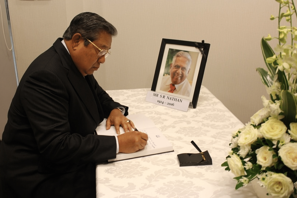 Indonesia's former President Susilo Bambang Yudhoyono signs the condolence book at the Embassy of the Republic of Singapore in Jakarta.