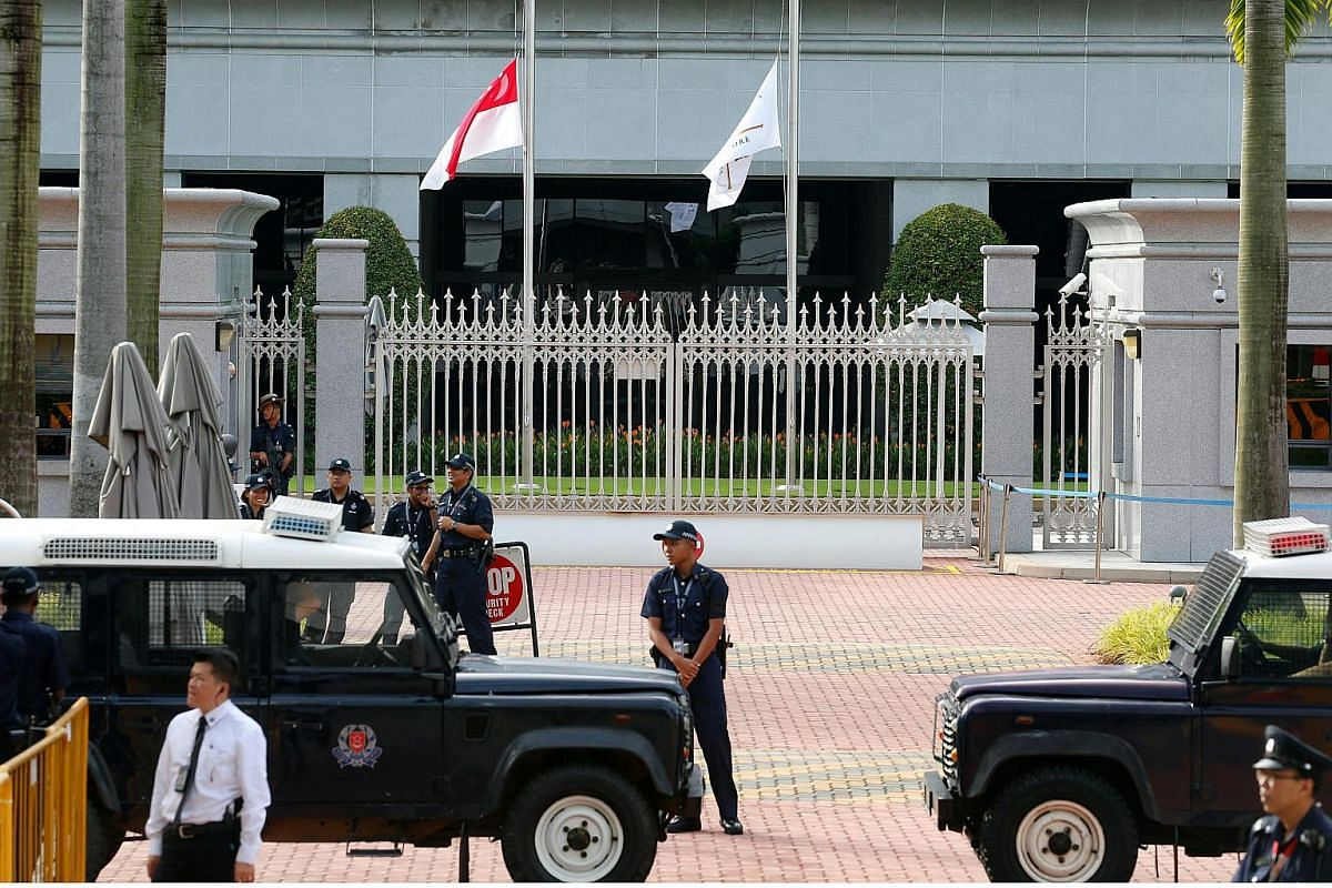Police waiting for the arrival of Mr S R Nathan's casket at Parliament House.
