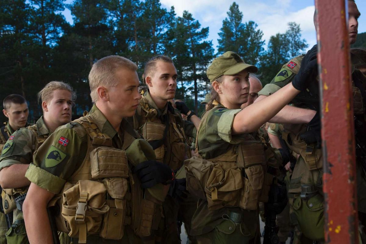 A female army recruit attends a base training next to male recruits at the armoured battalion in Setermoen, northern Norway, on Aug 11, 2016.