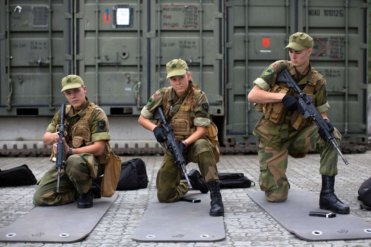 Army recruits attend a base training at the armoured battalion in Setermoen, northern Norway, on Aug 11, 2016.