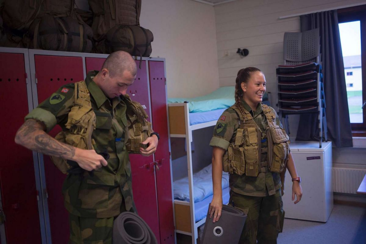 A female and male army recruits in their barracks for base training at the armoured battalion in Setermoen, northern Norway, on Aug 11, 2016.