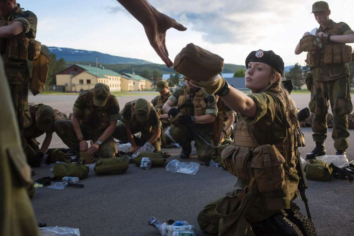 A female army recruit attends a base training with male recruits at the armoured battalion in Setermoen, northern Norway, on Aug 11, 2016.