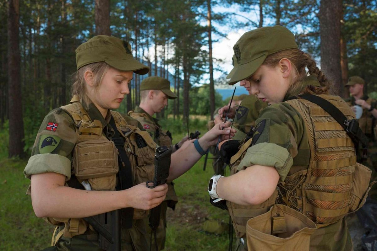 Female army recruits attend a base training at the armoured battalion in Setermoen, northern Norway, on Aug 11, 2016.