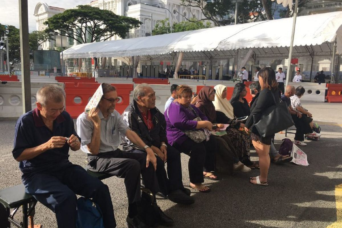 People waiting outside Parliament House to pay their respects to Mr S R Nathan on Aug 25.