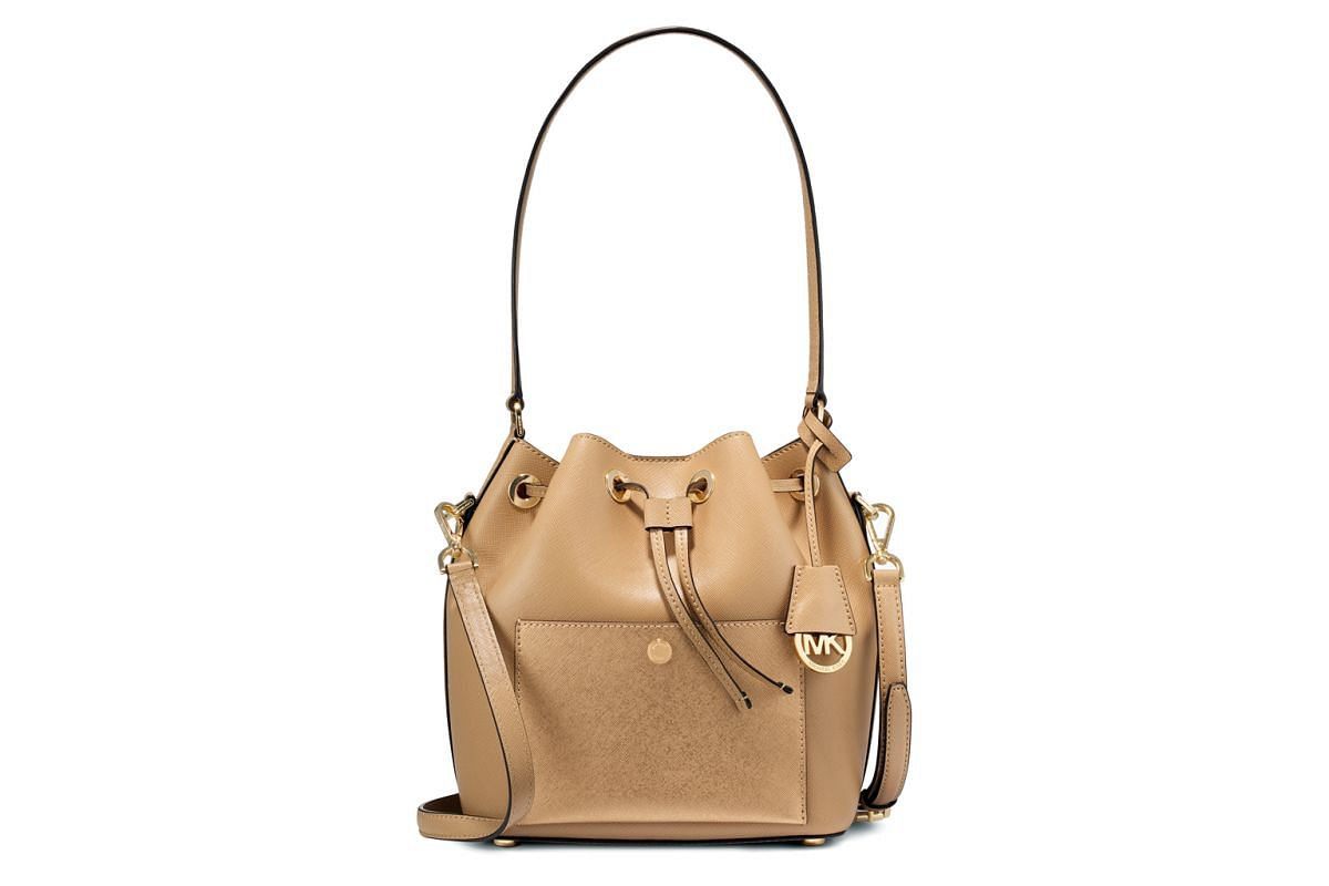 One of Michael Kors' popular totes, the dark camel/pale gold Greenwich MD Saffiano bucket bag, $579, available in Singapore.
