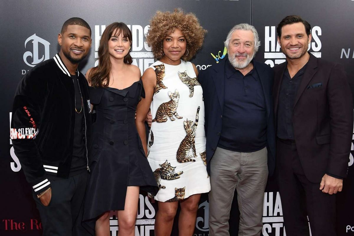 At the premiere in New York on Aug 22, (from left) Usher, Cuban actress Ana de Armas, Grace Hightower, Robert De Niro and Venezuelan actor Edgar Ramirez pose for the camera at the premiere of Hands Of Stone in New York City.