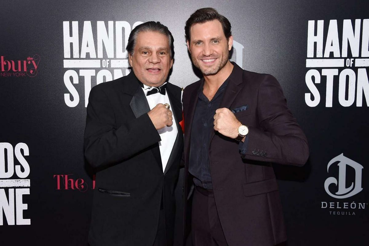 Actor Edgar Ramirez (right) posing with boxer Roberto Duran, the man he portrays in the movie Hands Of Stone, at the film premiere at SVA Theater on Aug 22 in New York City.