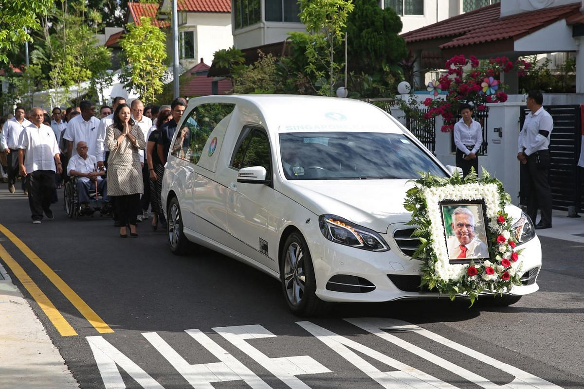 The casket bearing the body of former president Mr S R Nathan leaves his house at Ceylon Road for Parliament house on Aug 25.