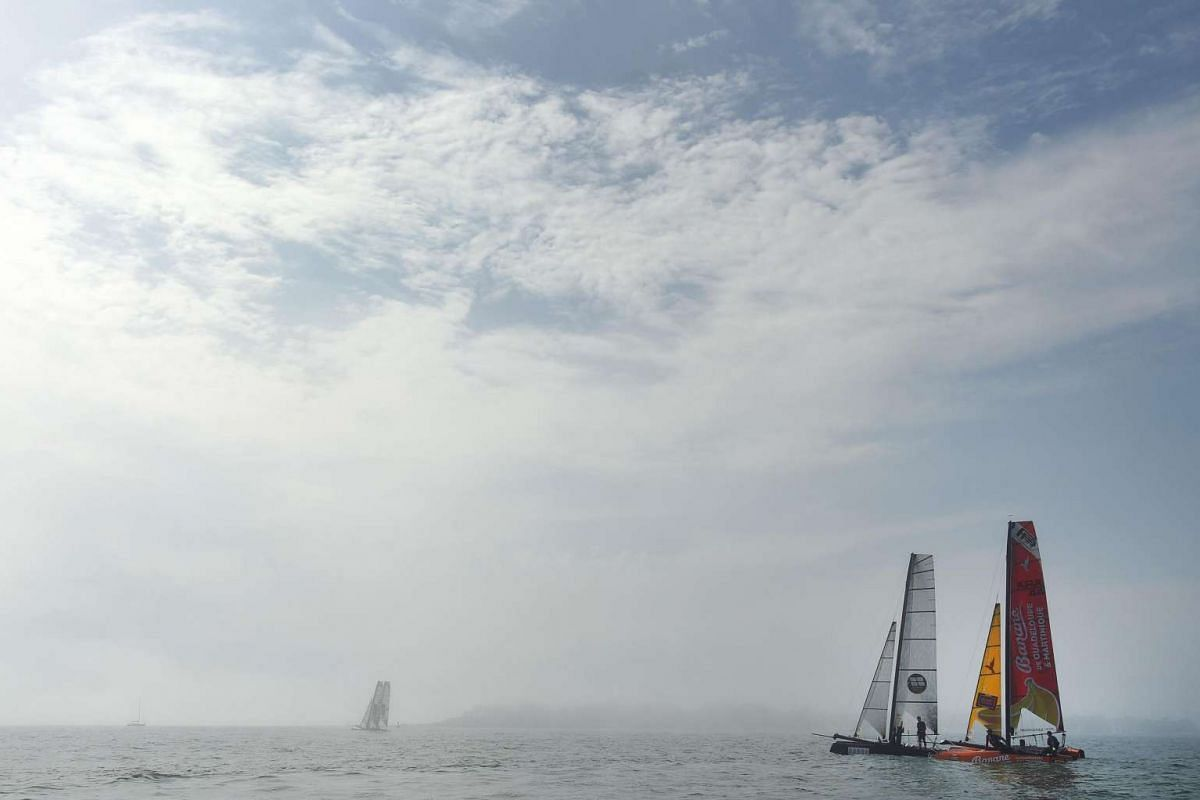 Sailors compete in a regatta aboard their flying phantom series, a new generation of foiling catamarans, on Aug 24 in La Baule, western France.