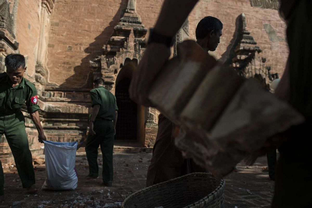Myanmar military collect the broken pieces and bricks at the damaged, ancient Htilominlo Temple, on Aug 25 after a 6.8-magnitude earthquake hit Bagan.