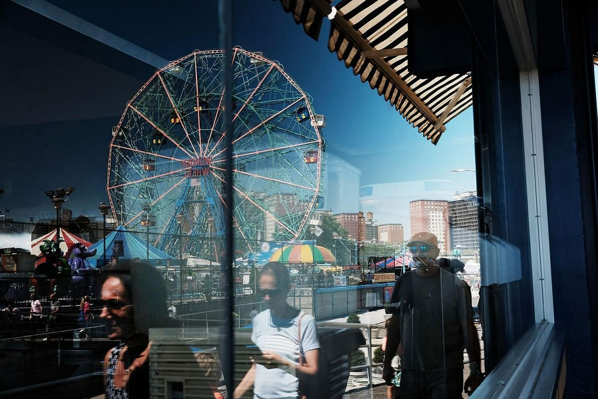 People head to the beach at Coney Island during a week of ideal summer weather in New York City on Aug 24.