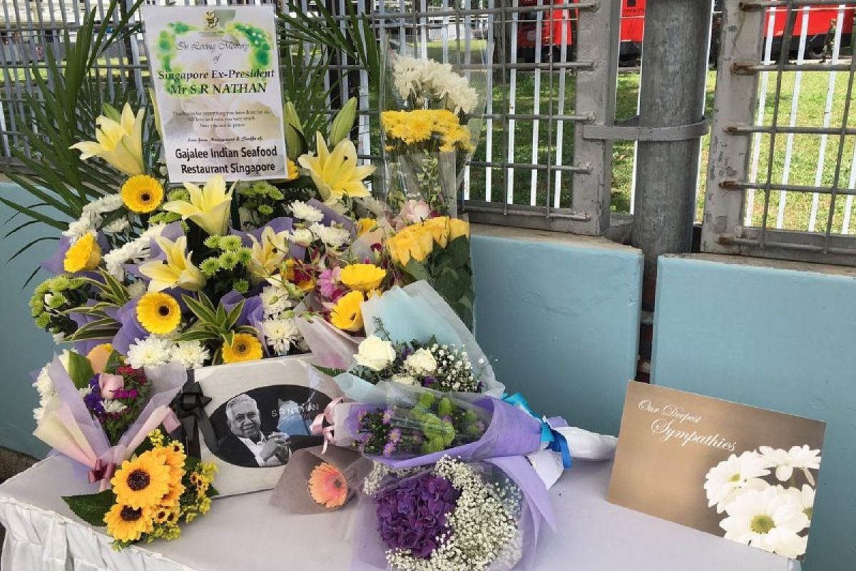 Some of the hampers and bouquets of flowers sent by mourners.