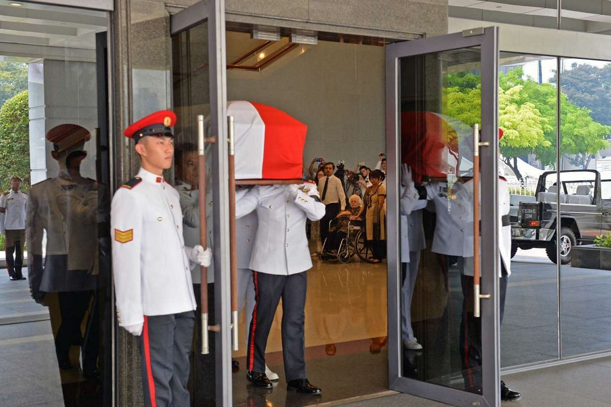 The family of former president S R Nathan look on as the coffin bearer party takes his casket onto the ceremonial gun carriage at Parliament House on Aug 26, 2016.