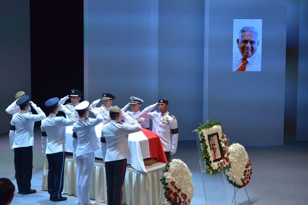 The pallbearers saluting as they prepare to carry the coffin of the late former president S R Nathan out of the University Cultural Centre on Aug 26, 2016.