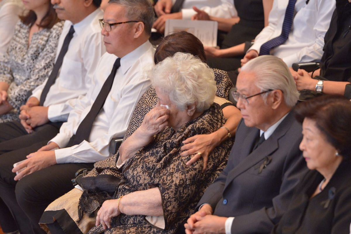 Mrs Urmila Nathan, seated next to Singapore President Tony Tan Keng Yam and his wife Mary, cries during the state funeral for her husband, the late former president S R Nathan, at the University Cultural Centre, on Aug 26, 2016.
