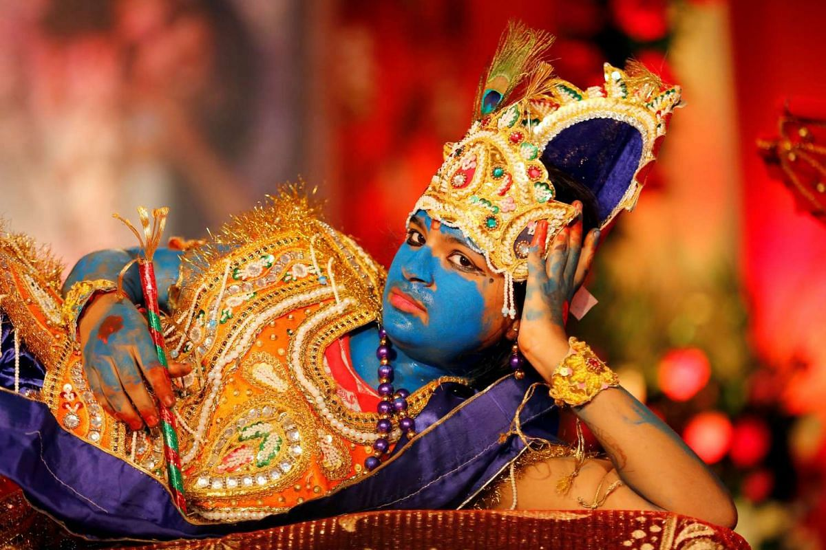 A girl dressed up as Hindu Lord Krishna performs during Janmashtami festival celebrations marking the birth of Lord Krishna, in Ahmedabad, India on Aug 25, 2016.