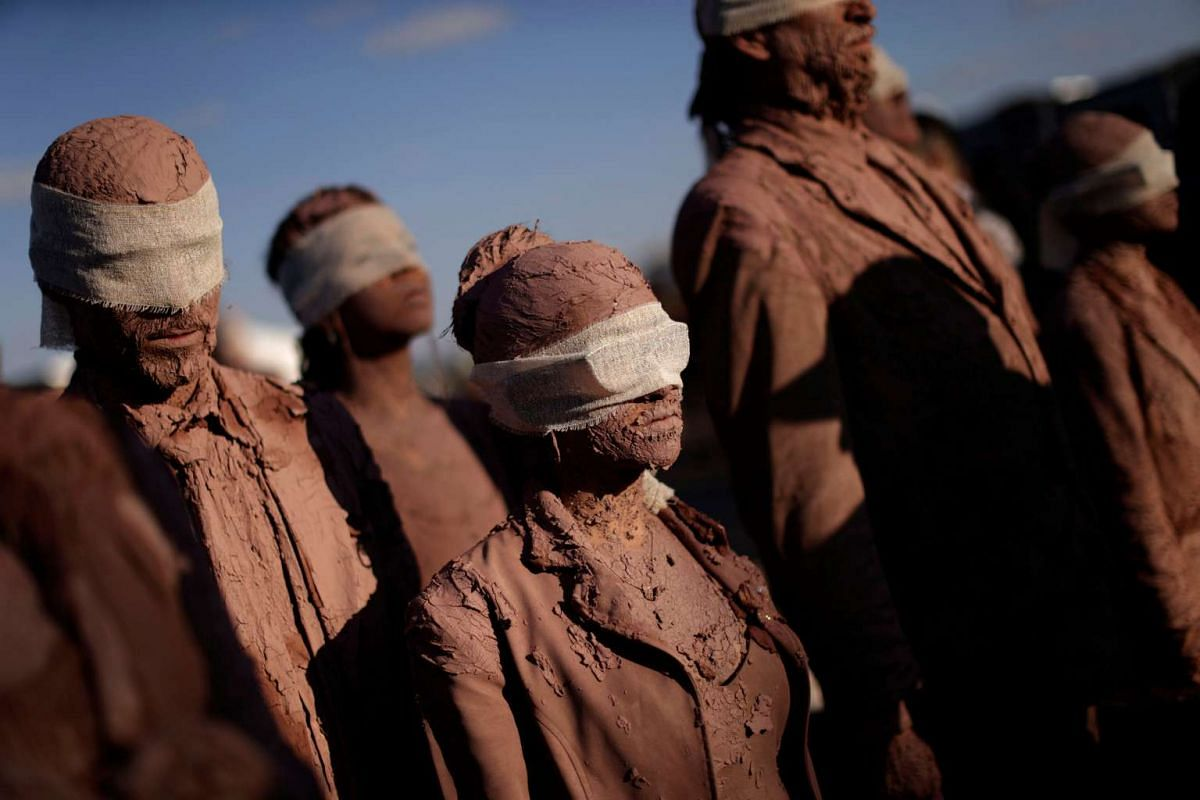 """Artists from the Deviation Collective group take part in the performance called """"Cegos"""" or Blind, in front of the Planalto Palace, in Brasilia, Brazil on Aug 25, 2016."""