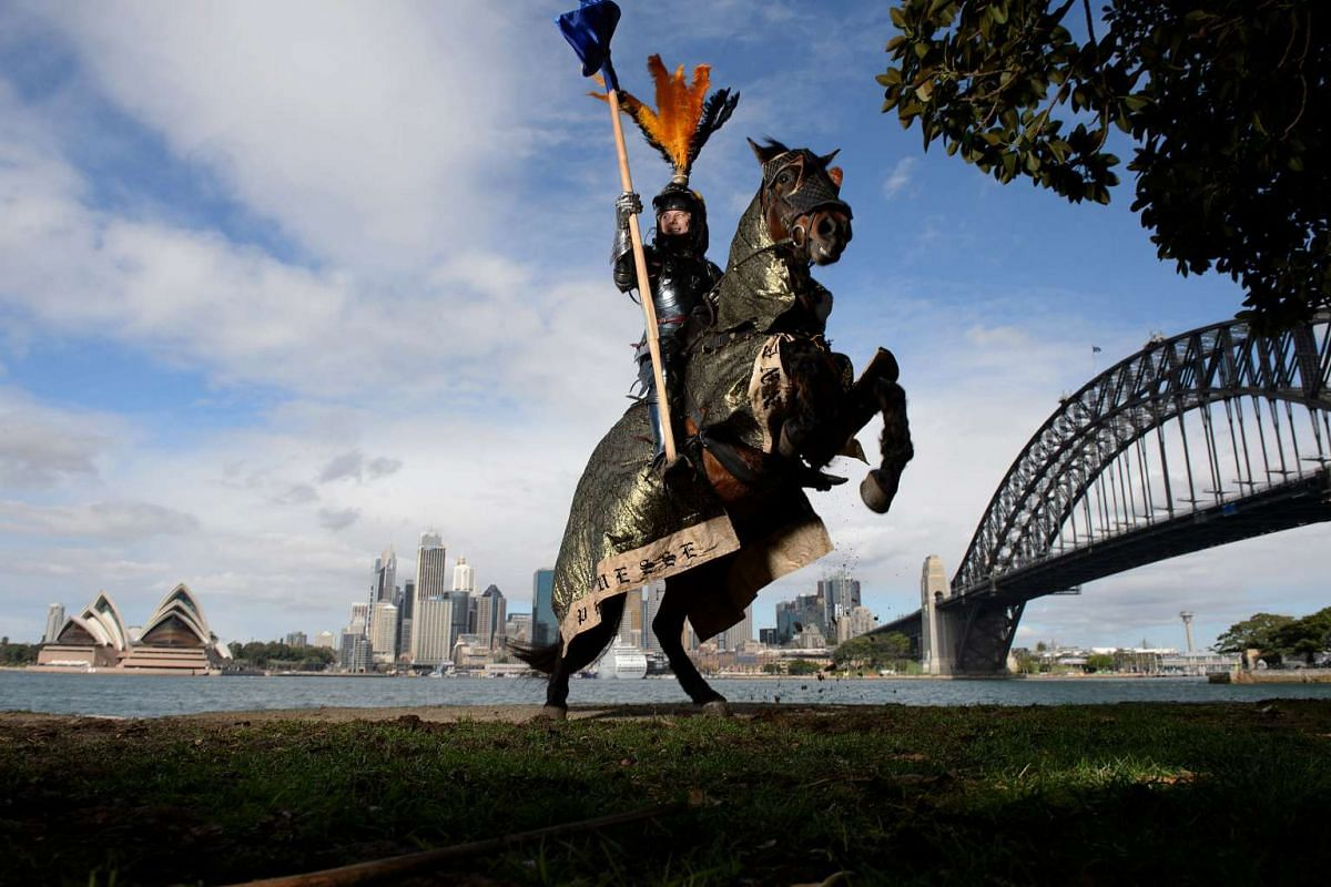 """Two-time World Medieval Jousting champion Rod Walker poses for a photograph on his horse """"Crusader"""" in Sydney, Australia on Aug 26, 2016."""