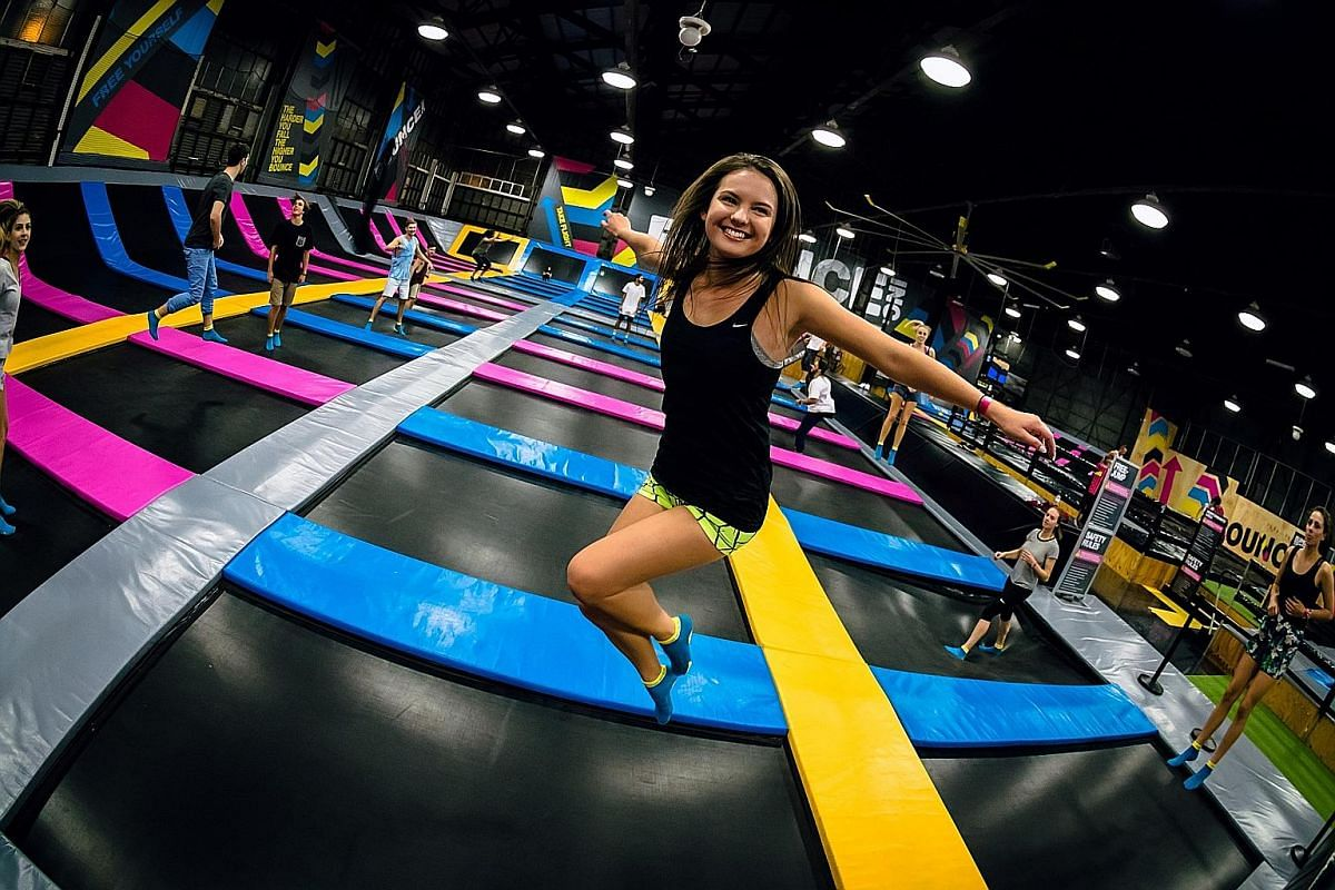 Bounce Singapore, which occupies the entire top floor of Cathay Cineleisure, includes facilities such trampolines (above) and an obstacle course.