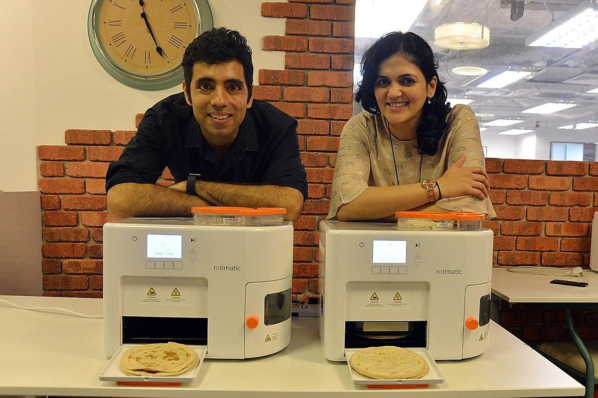 Mr Rishi Israni and his wife Pranoti Nagarkar Israni with their invention, the Rotimatic.