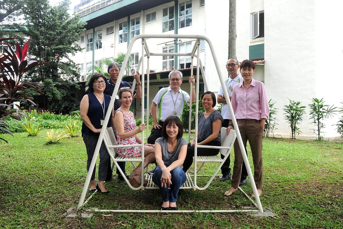 Volunteers (from left) Jeanette Wee, Francis Lim, Jaki Fisher, Tio Guat Kuan (sitting), Ng Seng Chuan, Angela Sho, Paul Koh and Ashleigh Quek provide a comforting presence to patients with no family or close friends in their final hours at Assisi Hos