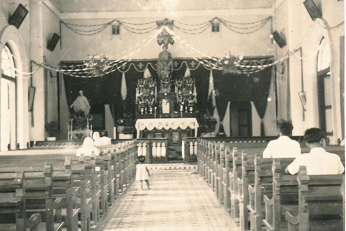 The interior of St Joseph's Church in 1949. The old church could seat only up to 250 people. By 1950, many had to stand on the sides during mass. Father Joachim Teng built a new church