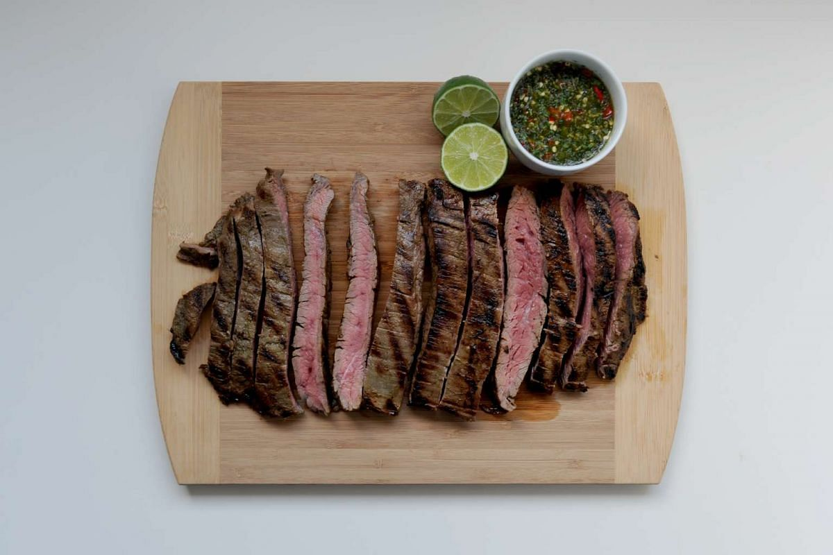 Sear flank steak for a short time to get the meat to medium-rare or medium.