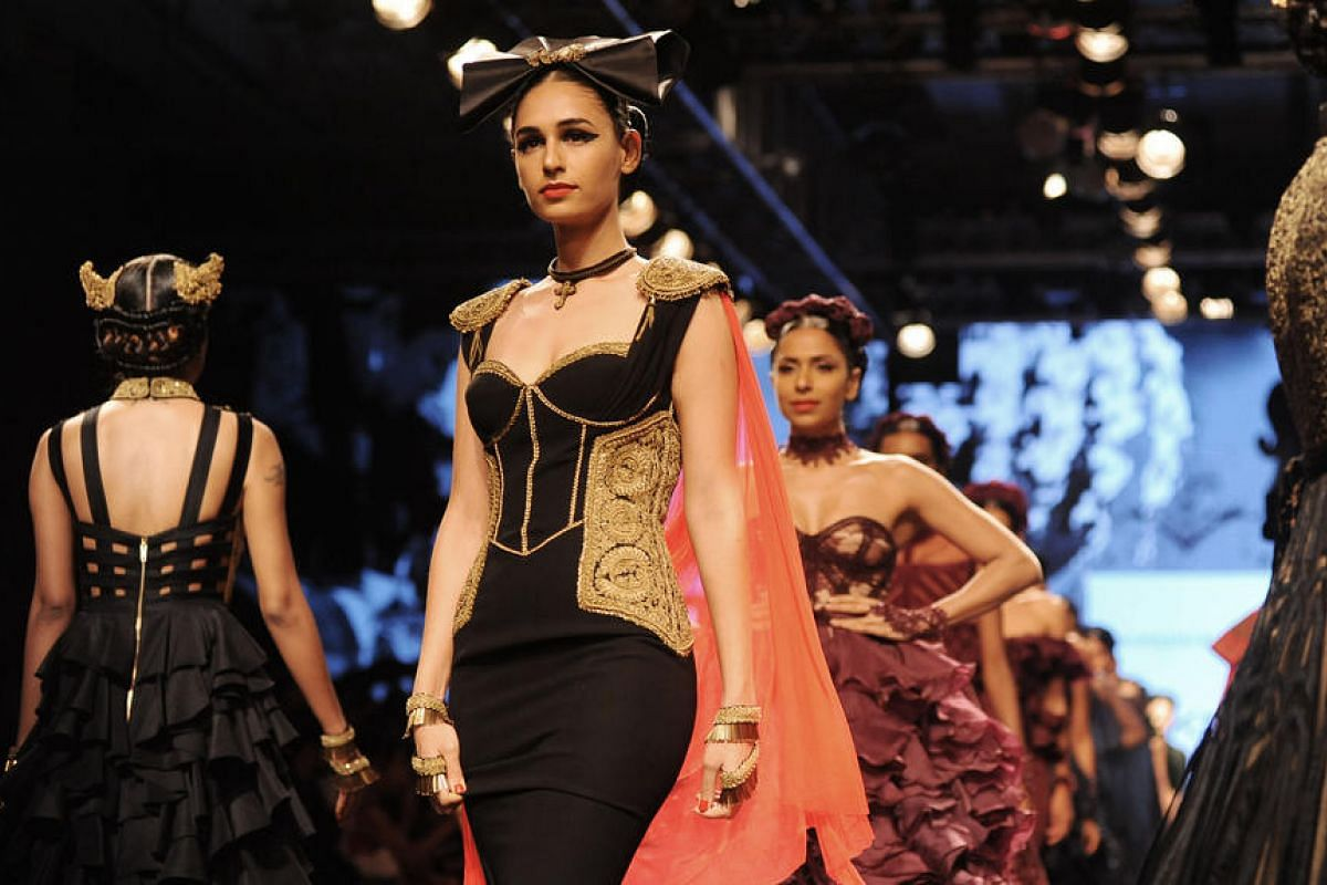 Indian models showcase creations by designer Shantanu & Nikhil during the Grand Finale of Lakme Fashion Week in Mumbai, India, on Aug 28.