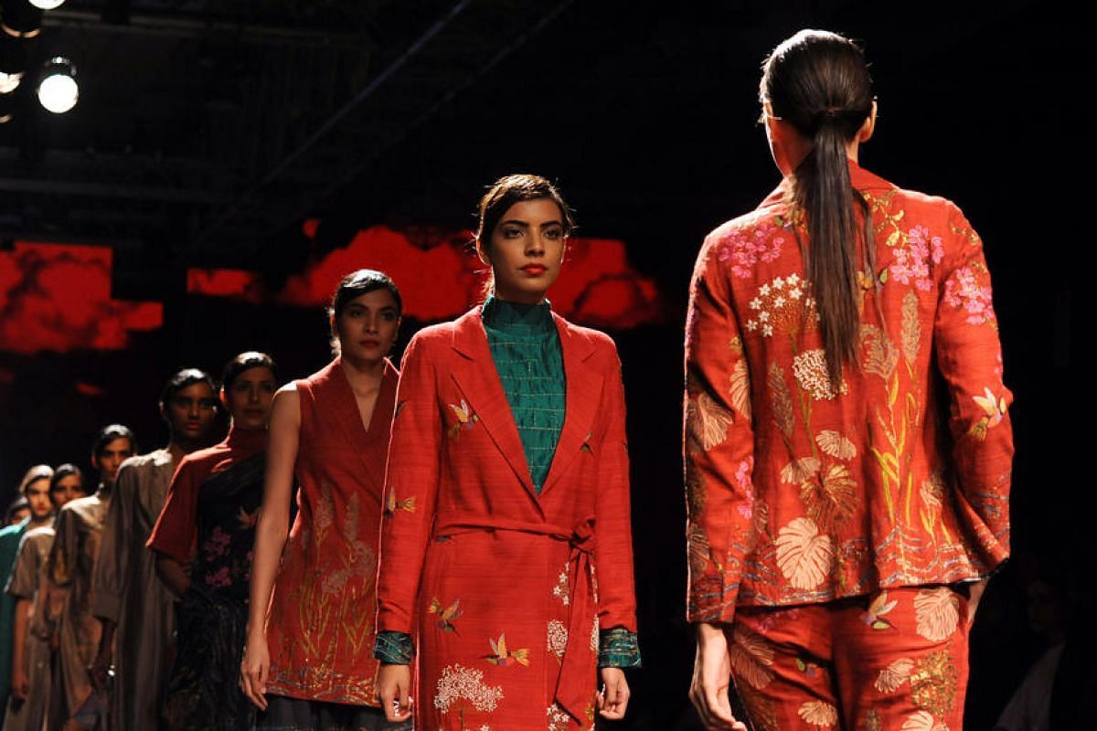 Indian models showcase a creation by designer Veent Rahul during the Grand Finale of Lakme Fashion Week in Mumbai, India, on Aug 28.