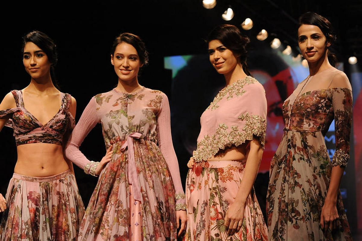 Indian models showcase creations by designer Anushree Reddy during the Grand Finale of Lakme Fashion Week in Mumbai, India, on Aug 28.